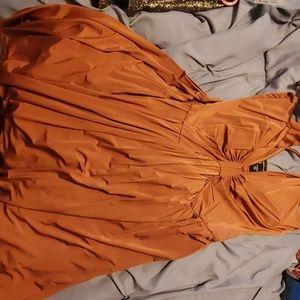Tan/ golden brown pleated dress.  Ties behind